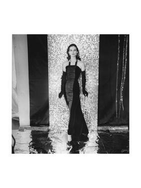 Model Anne St. Marie Earing Straight Halter-Neck Velvet-And-Moire Gown and Long Gloves by Henry Clarke