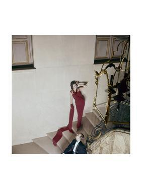 Model on Stairs Wearing Red Silk Cr-Pe Evening Dress by Henry Clarke