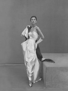 Model Wearing Manguin's White Satin Gown, Mink Stole, and Pearls by Henry Clarke