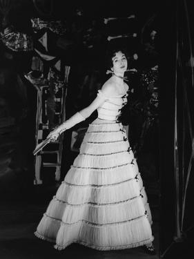 Model Wearing Tiered Tulle Gown Ringed with Black Grosgrain by Balmain by Henry Clarke
