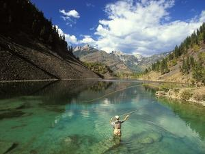 Young Man Fly-fishing on Lower Silver Springs Lake in the Elk Valley Near Fernie, British Columbia, by Henry Georgi