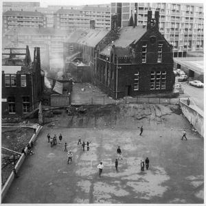 Children Playing in a Playground in Sheffield by Henry Grant