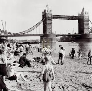 Londoners Relax on Tower Beach, c.1952 by Henry Grant