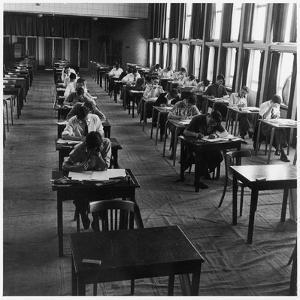 Students Taking their Exams at Hatfield Technical College by Henry Grant