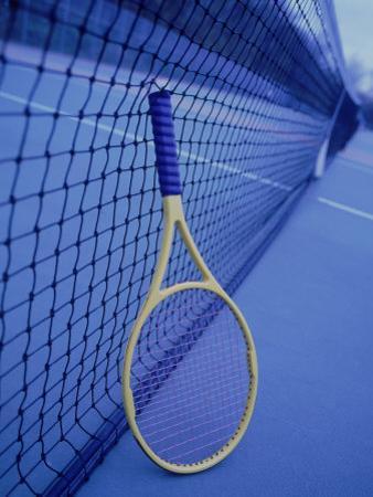 Tennis Racquet Against Net