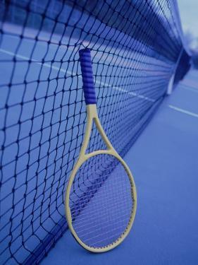Tennis Racquet Against Net by Henryk T. Kaiser