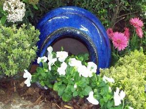 Urn & Spring Flowers by Herb Dickinson
