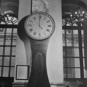 148 Year Old Clock at Wall Street by Herbert Gehr