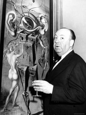 """Film Director Alfred Hitchcock, Standing Beside Salvador Dali's Painting """"Movies"""" by Herbert Gehr"""