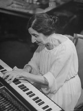Harpsichordist Wanda Landowska, at Home Playing the Harpsichord by Herbert Gehr