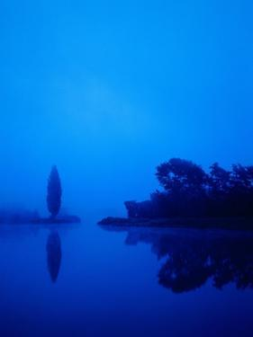 Landscape around a lake in the dawn by Herbert Kehrer