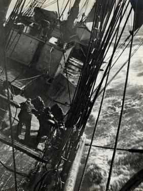 At the Pumps in a Gale in the Antarctic Ocean, 1912 by Herbert Ponting