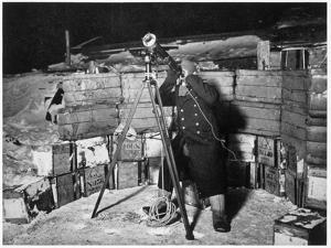 'Commander Evans observing an Occulation of Jupiter', Antarctica, 1910-1912 by Herbert Ponting