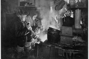'Oates and Meares at the Blubber Stove in the Stables', Antarctica, 1911 by Herbert Ponting