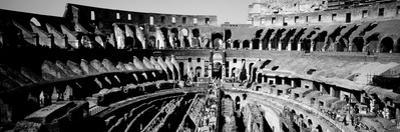High Angle View of Tourists in an Amphitheater, Colosseum, Rome, Italy