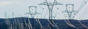 High Voltage Power Lines Spanning Rolling Hills