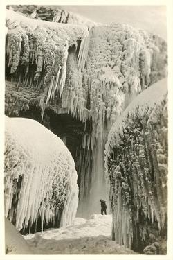 Hiker in Frozen Waterfall