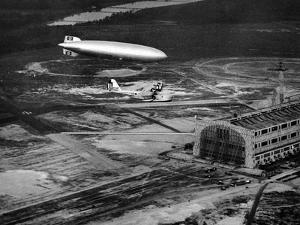 Hindenburg's Arrival with an Escort Plane over Lakehurst, New Jersey
