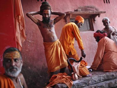 Hindu Holy Men Relax after Taking Holy Dip in River Ganges During the Kumbh Mela Festival in India
