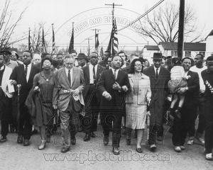 Historical Martin Luther King, Jr. & his wife Coretta Scott King lead a black voting rights march i