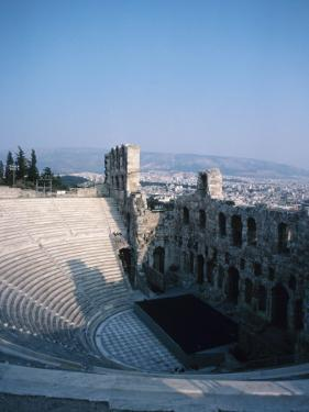 Historical Theater Ruins with Landscape of City in the Background in Athens, Greece