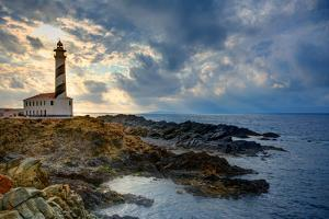 Cap De Favaritx Sunset Lighthouse Cape in Mahon at Balearic Islands of Spain by holbox