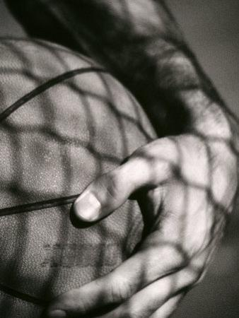 Holding the Basketball