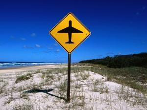 Aeroplane Warning Sign on Beach, Eurong, Queensland, Australia by Holger Leue
