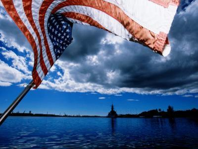 American Flag and Uss Missouri at Pearl Harbour, USA