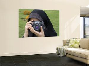 Iranian Girl with Camera by Holger Leue