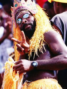 Man in Orange Costume, Crop-Over Festival, Bridgetown by Holger Leue