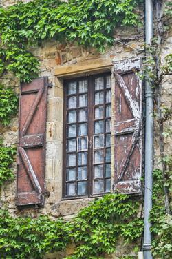 France, Cordes-sur-Ciel. Weathered shutters and window. by Hollice Looney