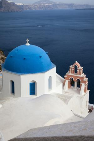 Greece, Santorini. Blue dome and bell tower by Hollice Looney