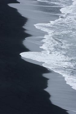 Iceland, Ingolshofdi, Water Rushing Up on Lava Sand by Hollice Looney