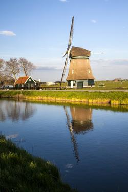 Netherlands, Lisse, Windmill on a Canal by Hollice Looney