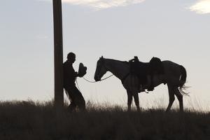 Usa, Wyoming, Shell, The Hideout Ranch, Silhouette of Man and Horse at Sunset by Hollice