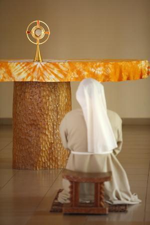 https://imgc.allpostersimages.com/img/posters/holy-sacrament-adoration-at-akepe-monastery-akepe-togo_u-L-Q1GYJR80.jpg?artPerspective=n