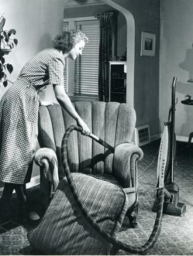 Homemaker Vacuuming, USA, 1950