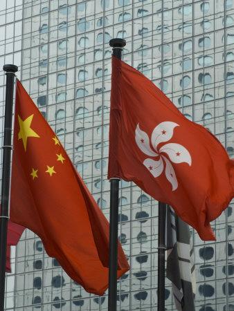 https://imgc.allpostersimages.com/img/posters/hong-kong-and-chinese-flags-fly-in-central-hong-kong-china_u-L-P7NUIO0.jpg?p=0