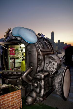 https://imgc.allpostersimages.com/img/posters/hong-kong-waterfront-cafe-at-dusk_u-L-Q1AS6Q10.jpg?artPerspective=n