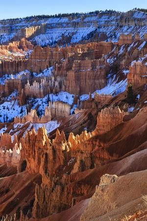 https://imgc.allpostersimages.com/img/posters/hoodoos-and-snowy-rim-cliffs-lit-by-strong-late-afternoon-sun-in-winter_u-L-PQ8N8Z0.jpg?p=0