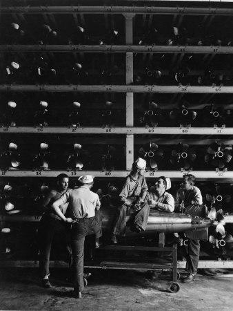 Torpedo Men Relaxing Beneath Rows of Deadly Torpedoes in Torpedo Shop During WWII