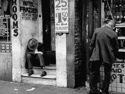 Vagrant Sitting in Doorway