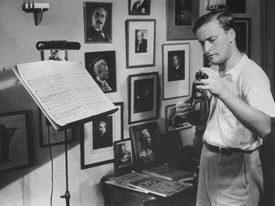 Violinist Yehudi Menuhin, 20, Tuning His Violin, Prepares to Practice the Schumann Violin Concerto