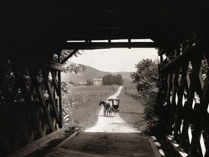 Horse and Buggy Viewed through Covered Bridge