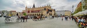 Horse coaches and Cloth Hall at market square, Krakow, Poland