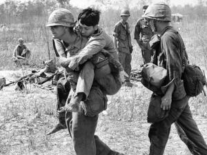 Vietnam War U.S. Aid Enemy Wounded by Horst Faas