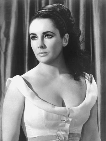https://imgc.allpostersimages.com/img/posters/hotel-international-the-v-i-p-s-d-anthony-asquith-with-elizabeth-taylor-1963-b-w-photo_u-L-Q1C253W0.jpg?artPerspective=n