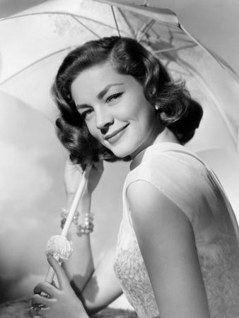 https://imgc.allpostersimages.com/img/posters/how-to-marry-a-millionaire-lauren-bacall-1953_u-L-PH2X460.jpg?artPerspective=n