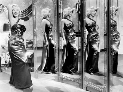 https://imgc.allpostersimages.com/img/posters/how-to-marry-a-millionaire-marilyn-monroe-1953_u-L-PH3NFQ0.jpg?artPerspective=n